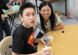 Volunteer chatting blind people